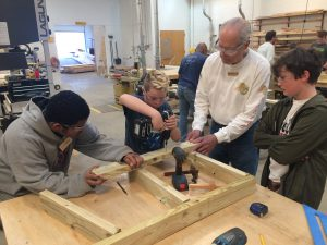 Students and mentors build dog houses
